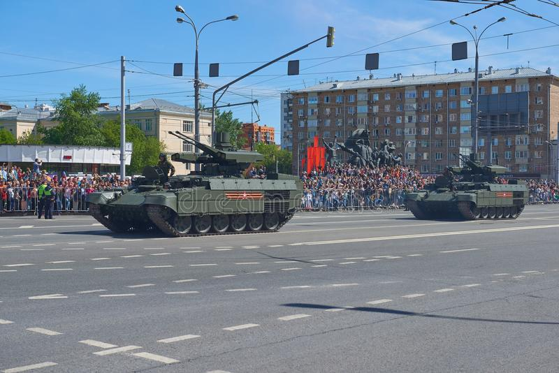 MOSCOW, MAY, 9, 2018: Great Victory holiday parade of Russian military vehicles. Celebrating people, Victory symbols in the backgr. Ound. Russian battle tank BMP royalty free stock image