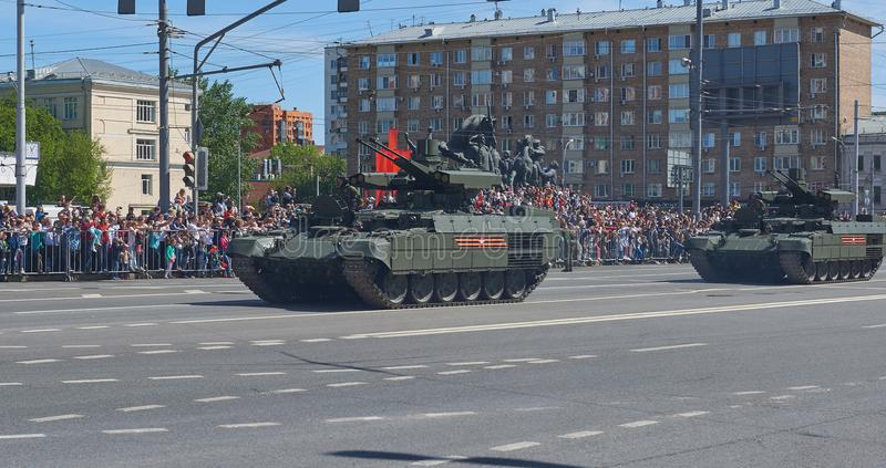 MOSCOW, MAY, 9, 2018: Great Victory holiday parade of Russian military vehicles. Celebrating people, Victory symbols in the backgr. Ound. Russian battle tank BMP stock image