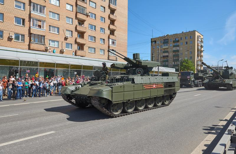 MOSCOW, MAY, 9, 2018: Great Victory holiday parade of Russian military vehicles. Celebrating people, Victory symbols in the backgr. Ound. Russian battle tank BMP stock photo