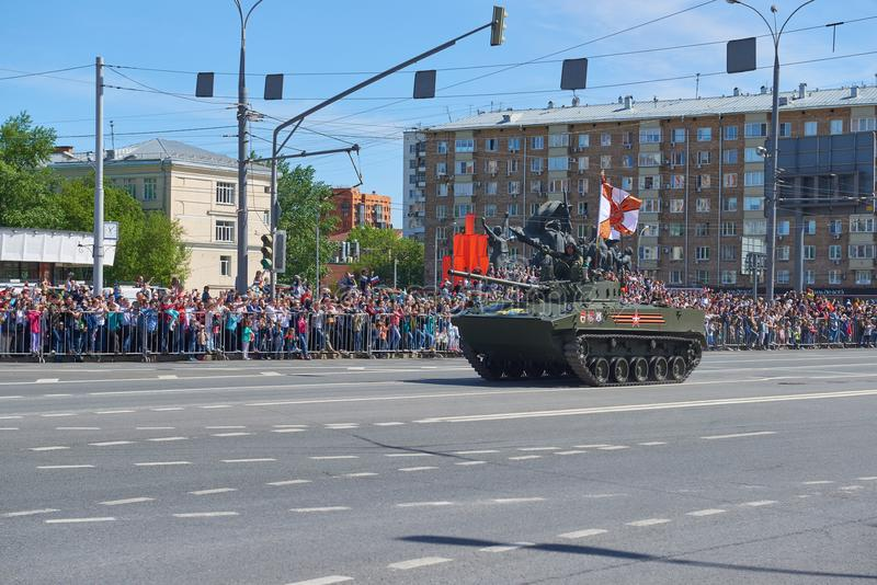 MOSCOW, MAY, 9, 2018: Great Victory holiday parade of Russian military vehicles. Celebrating people, Victory symbols in the backgr. Ound. Russian light battle royalty free stock photography