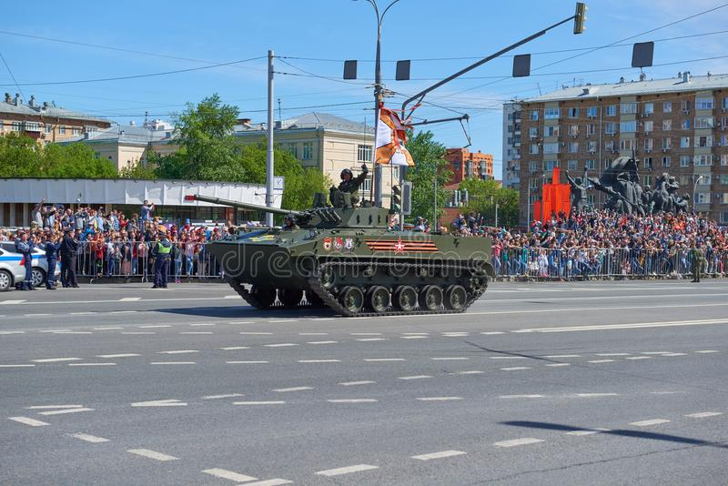 MOSCOW, MAY, 9, 2018: Great Victory holiday parade of Russian military vehicles. Celebrating people, Victory symbols in the backgr. Ound. Russian light battle stock photography
