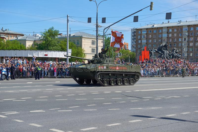MOSCOW, MAY, 9, 2018: Great Victory holiday parade of Russian military vehicles. Celebrating people, Victory symbols in the backgr. Ound. Russian light battle stock photo