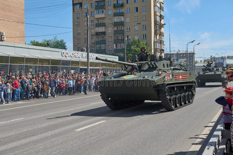 MOSCOW, MAY, 9, 2018: Great Victory holiday parade of Russian military vehicles. Celebrating people, Victory symbols in the backgr. Ound. Russian light battle stock image
