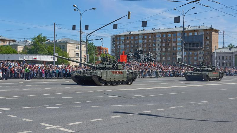 MOSCOW, MAY, 9, 2018: Great Victory holiday parade of Russian military vehicles. Tanks on city streets and celebrating people, red. Flags, Victory symbols in royalty free stock photos
