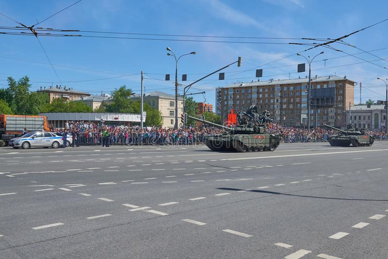 MOSCOW, MAY, 9, 2018: Great Victory holiday parade of Russian military vehicles. Tanks on city streets and celebrating people, red. Flags, Victory symbols in stock photography