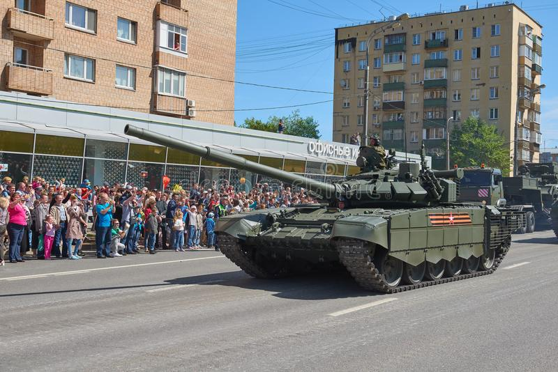 MOSCOW, MAY, 9, 2018: Great Victory holiday parade of Russian military vehicles. Tanks on city streets and celebrating people, red. Flags, Victory symbols in stock image