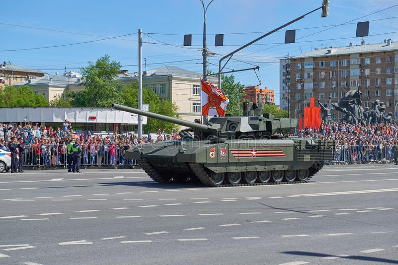 MOSCOW, MAY, 9, 2018: Great Victory holiday parade of Russian military vehicles. Tanks on city streets and celebrating people, Vic. Tory symbols in the royalty free stock photos