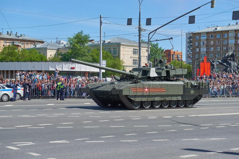 MOSCOW, MAY, 9, 2018: Great Victory holiday parade of Russian military vehicles. Tanks on city streets and celebrating people, Vic. Tory symbols in the stock photography