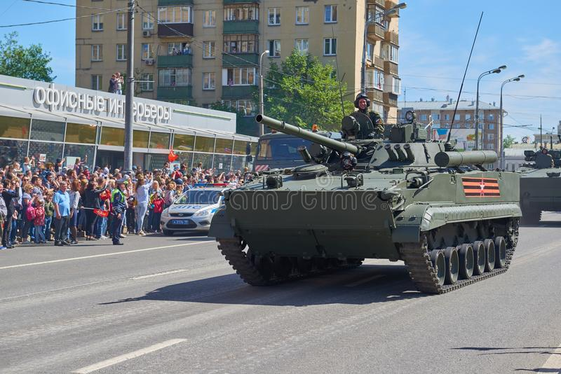 MOSCOW, MAY, 9, 2018: Great Victory holiday parade of Russian military vehicles. Tanks on city streets and celebrating people, Vic. Tory symbols in the royalty free stock photography