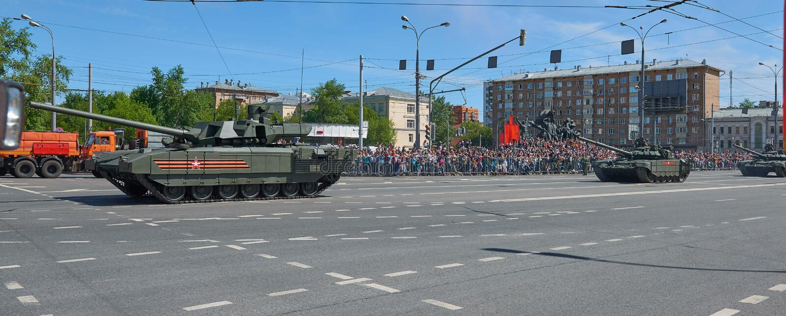 MOSCOW, MAY, 9, 2018: Great Victory holiday parade of Russian military vehicles. Tanks on city streets and celebrating people, Vic. Tory symbols in the stock image