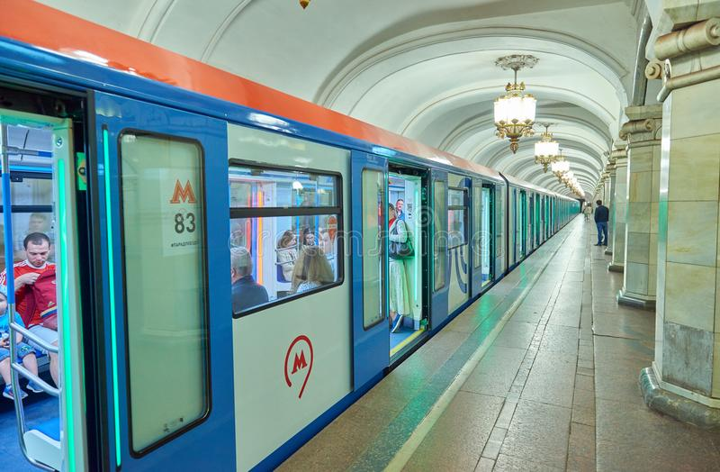 MOSCOW, MAY, 13, 2018: Perspective view of new modern subway passenger blue white train at metro station. People inside train. Rus royalty free stock photos