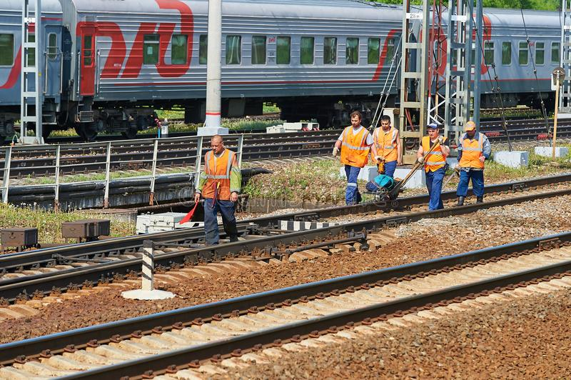 MOSCOW, MAY, 18, 2018: View of railway maintenance workes group with trolley doing rail tracks ultrasonic inspection and visual co stock photo