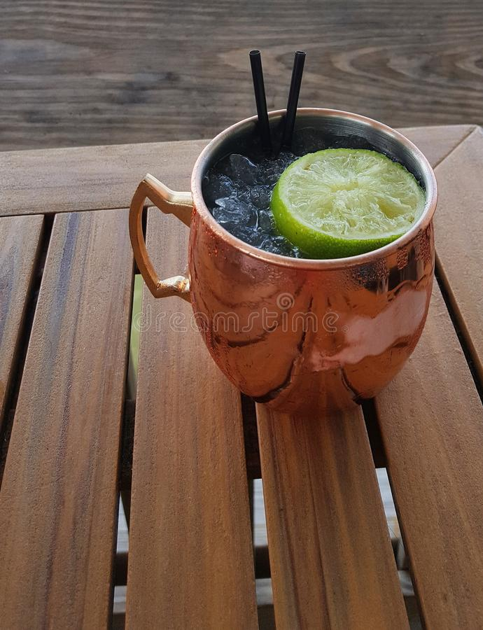 Moscow mule cocktail in copper mug stock photo