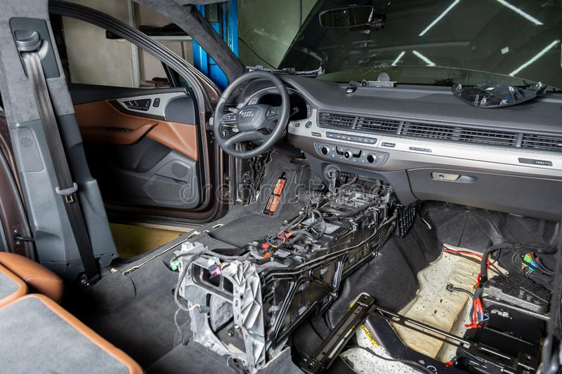 Moscow. November 2018. Audi car repair service center. Dismantled car interior. Check car wiring. Removed chairs, floor trim. stock images