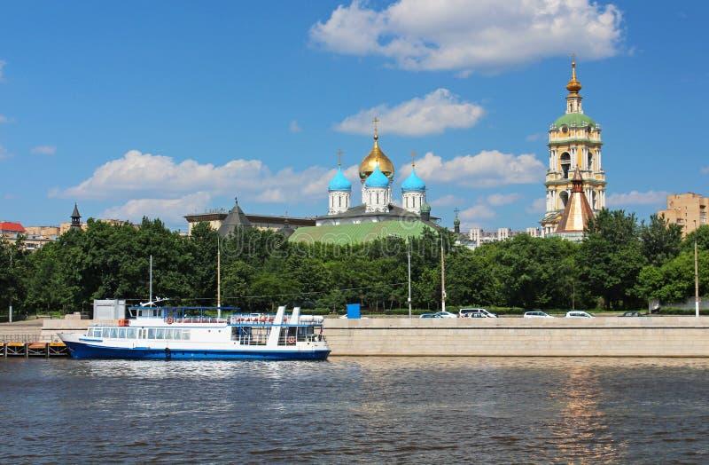 Moscow, Novospasskiy monastery and cruise boat royalty free stock photo