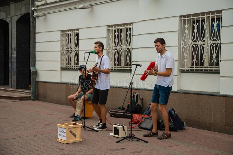 Moscow, Old Arbat Street musicians playing guitar. And singing into the microphone stock image