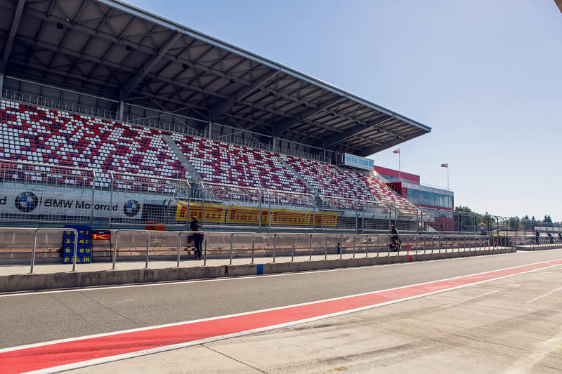 Moscow raceway with seats and people standing in the road outside the fence stock photos