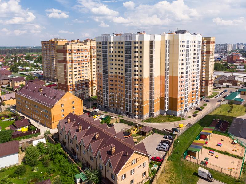 Moscow region landscape with high-rise and private houses stock photography
