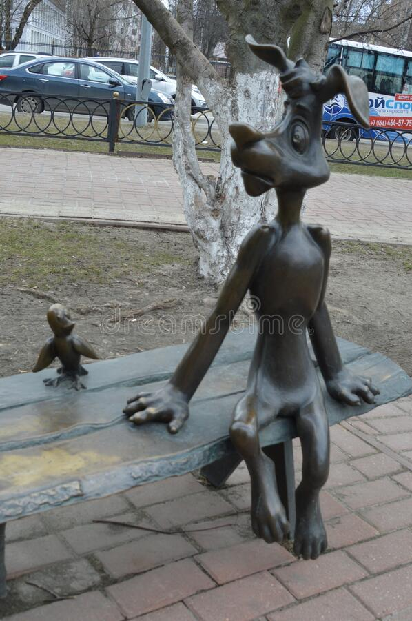 Moscow region, Ramenskoe, figure , cartoon `Prostokvashino` dog. Ball and galchenok on the bench stock photo
