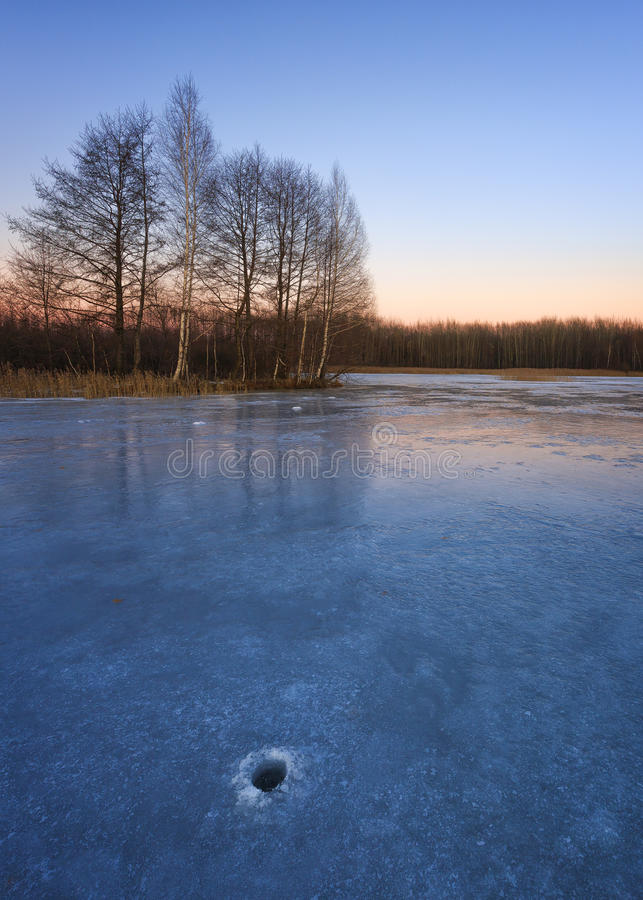 Moscow region, Russia. Sunset in the cold evening on the frozen lake stock photo