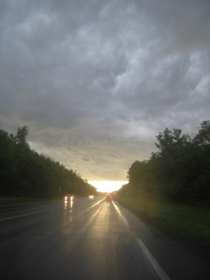Moscow region, 22.08.2009, wet road after rain. Cloud stock photography