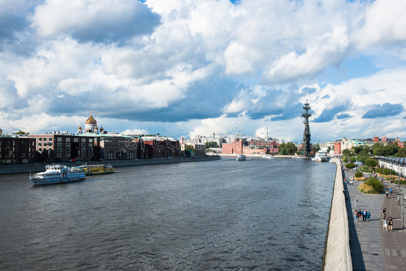 The Moscow river and luxury residential area. MOSCOW, RUSSIA - AUGUST 1, 2015: The Moscow river and luxury residential area along Prechistenskaya embankment left royalty free stock photos