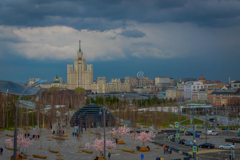 MOSCOW, RUSSIA- APRIL, 24, 2018: Above view of arbat street with unidentified tourists walking close to pink trees in royalty free stock photo