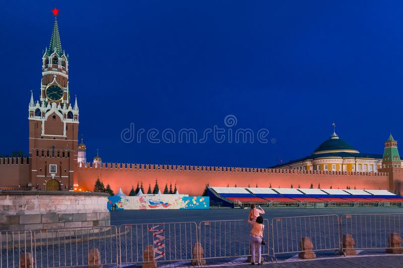 MOSCOW, RUSSIA - April 30, 2018: Child with her mother takes pictures with a phone from the Spasskaya Tower of the Moscow Kremlin. And the Palace of Senate from royalty free stock photos