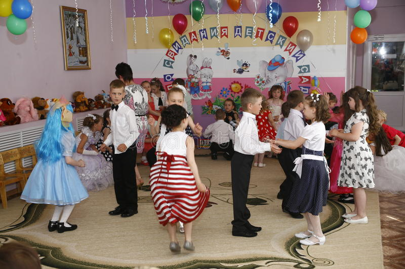 Moscow, Russia-April 17, 2014:children dancing and playing during a party in kindergarte stock images