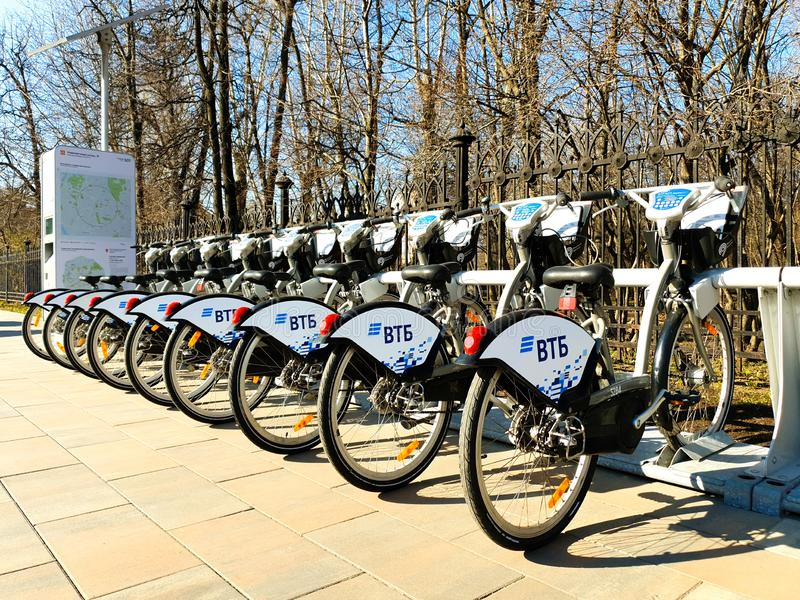 MOSCOW, RUSSIA - April 19, 2019. City bikes for hire at an automatic rental station in Moscow against royalty free stock image
