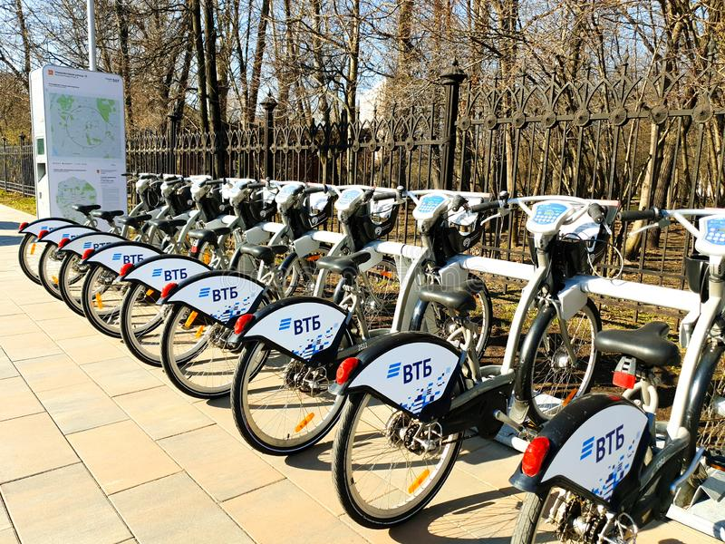 MOSCOW, RUSSIA - April 19, 2019. City bikes for hire at an automatic rental station in Moscow against stock images