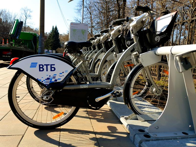 MOSCOW, RUSSIA - April 19, 2019. City bikes for hire at an automatic rental station in Moscow against stock photos