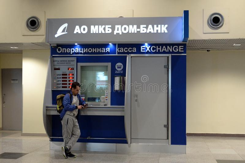 Currency exchange operating desk of the municipal commercial bank `DOM-BANK` `at the international airport `Domodedovo`. MOSCOW, RUSSIA - APRIL 26, 2018:Currency royalty free stock photo