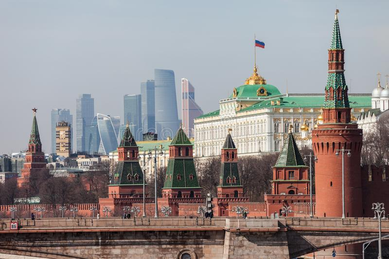 Grand Kremlin Palace Walls and Towers and modern Moscow International Business Center MIBC skyscrapers at Russia Moscow City. MOSCOW, RUSSIA - APRIL 5, 2018 stock images