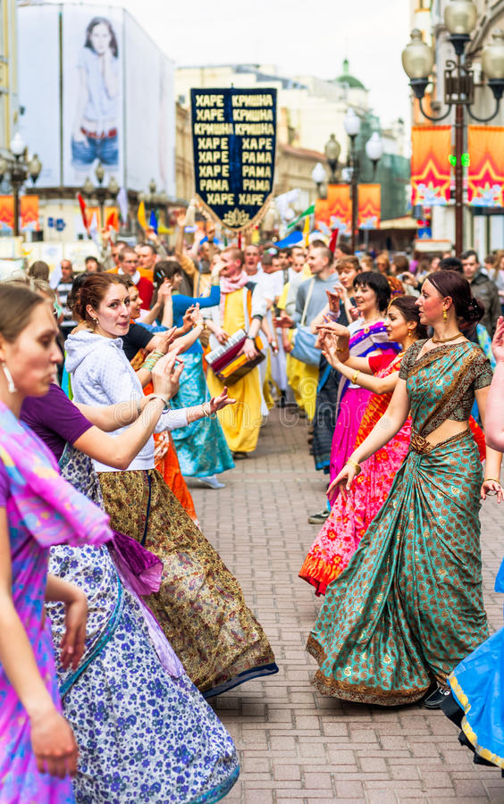 Hare Krishna members on Old Arbat. MOSCOW, RUSSIA - APRIL 30: Hare Krishna members on Old Arbat - a very popular tourist pedestrian street, in the heart of royalty free stock photos