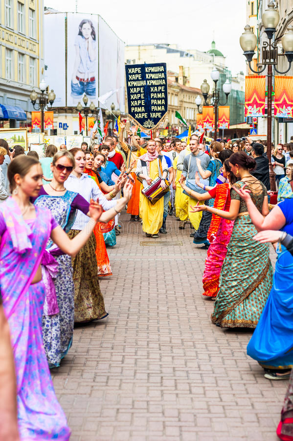 Hare Krishna members on Old Arbat. MOSCOW, RUSSIA - APRIL 30: Hare Krishna members on Old Arbat - a very popular tourist pedestrian street, in the heart of royalty free stock photography