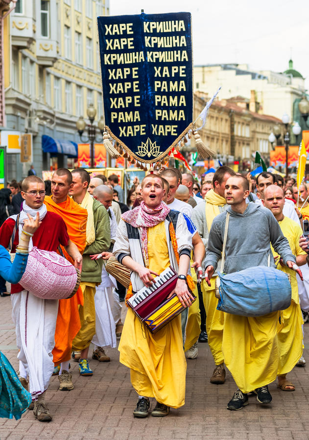Hare Krishna members on Old Arbat. MOSCOW, RUSSIA - APRIL 30: Hare Krishna members on Old Arbat - a very popular tourist pedestrian street, in the heart of stock image