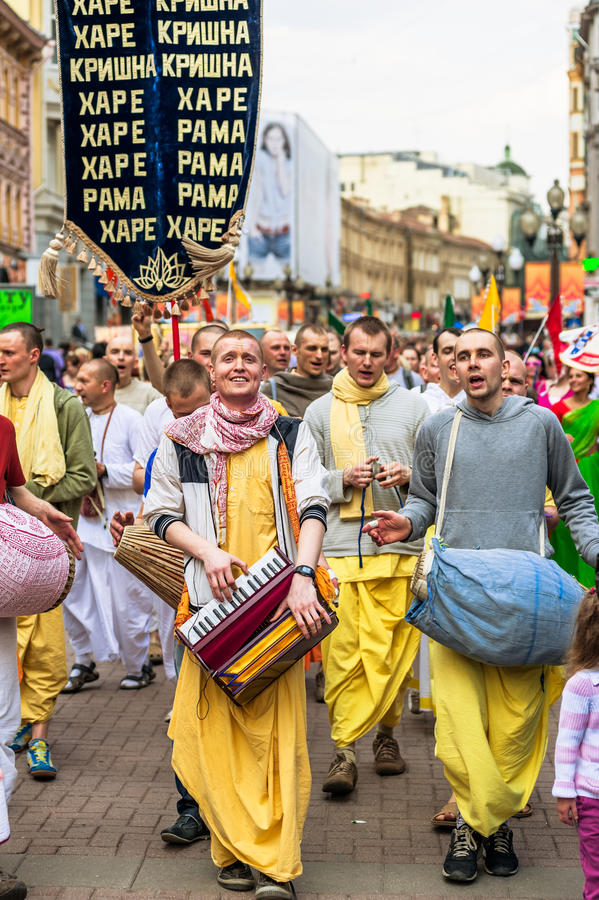 Hare Krishna members on Old Arbat. MOSCOW, RUSSIA - APRIL 30: Hare Krishna members on Old Arbat - a very popular tourist pedestrian street, in the heart of stock photos