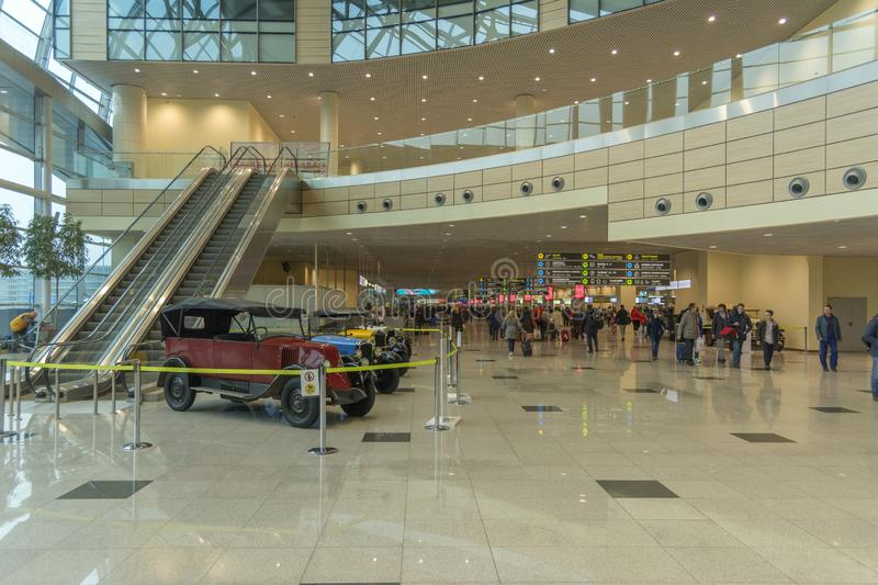 Moscow. Russia. 12 april 2019. The interior of the Moscow Domodedovo airport, DME. Exhibition of retro cars inside the terminal royalty free stock photo