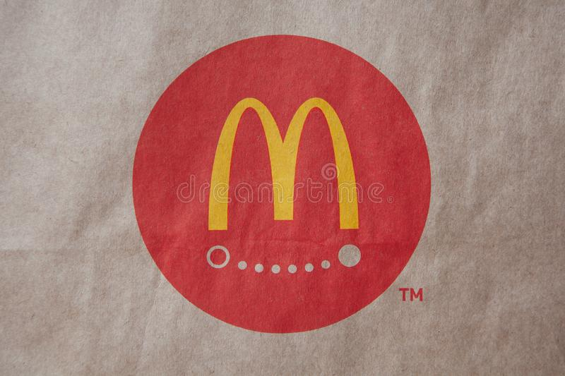 Moscow, Russia - April 06, 2019: McDonald`s logo food delivery on brown craft paper background. Close-up. Side view. Horizontal stock photos