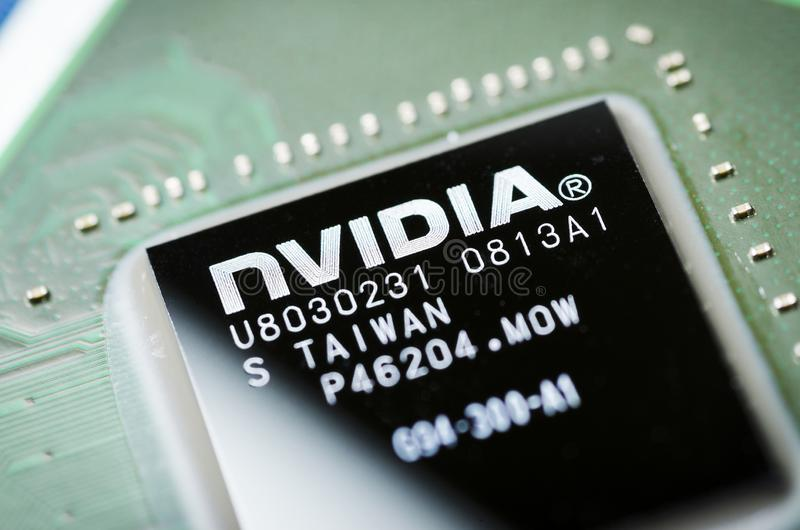 Moscow, Russia - April 7, 2019: NVIDIA microchip on the motherboard, close-up stock photography
