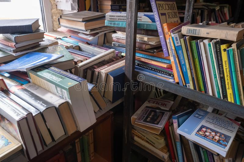 Old books on the shelf in an antique shop stock image