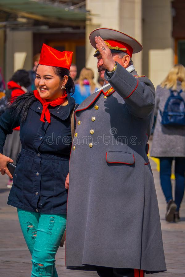 MOSCOW, RUSSIA- APRIL, 24, 2018: Outdoor view of unidentified woman hugging a man wearing a soldier uniform at outdoors. In Manezhnaya Square, in Moscos Russia stock photo