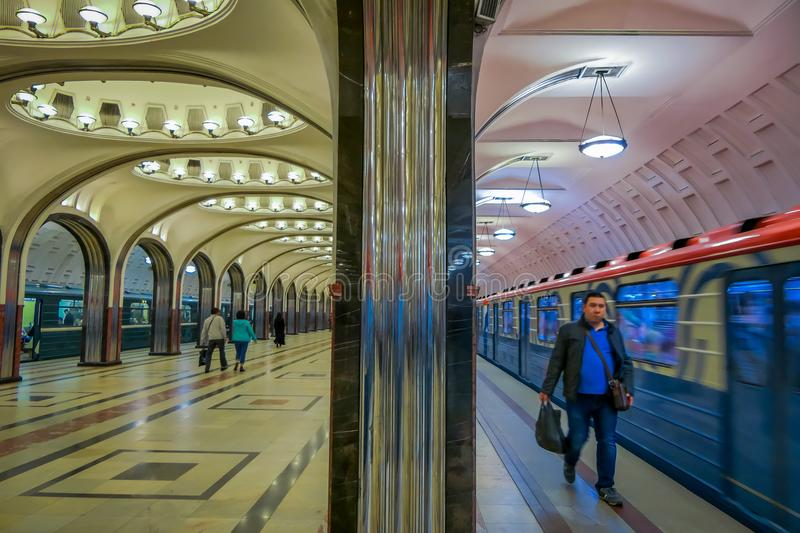 MOSCOW, RUSSIA- APRIL, 29, 2018: People walking inside of Mayakovskaya subway station in Moscow, Russia, Stalinist royalty free stock photography