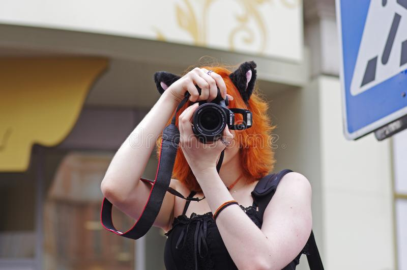 Portrait of a young woman with animal ears taking pictures on a flashmob on Arbat in Moscow royalty free stock image