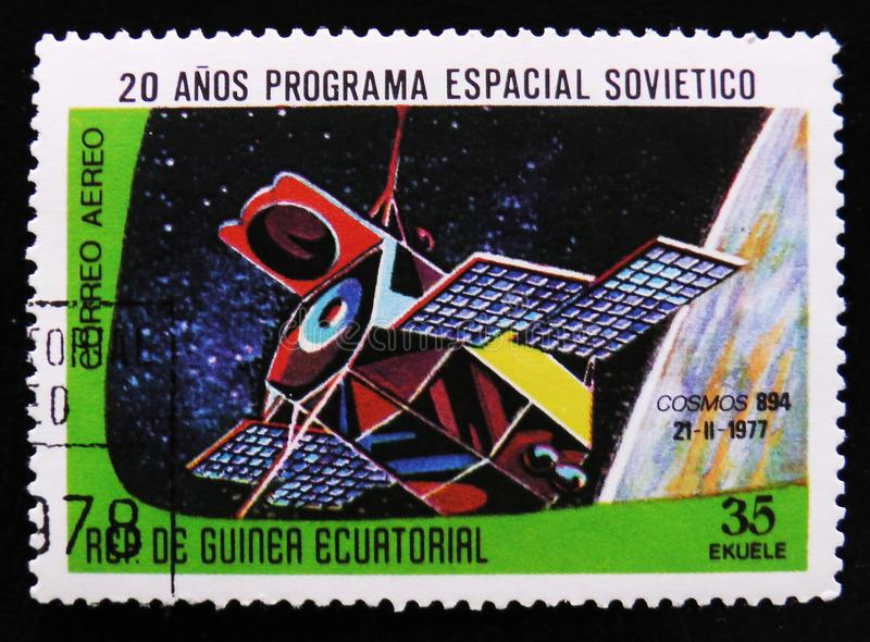 Space station Cosmos 894, circa 1978. MOSCOW, RUSSIA - APRIL 2, 2017: A post stamp printed in Equatorial Guinea shows space station Cosmos 894, circa 1978 royalty free stock photography