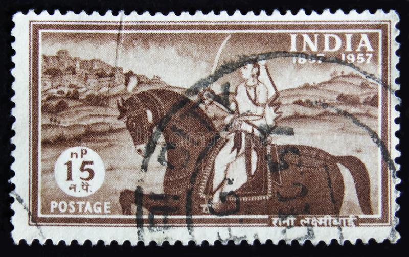 MOSCOW, RUSSIA - APRIL 2, 2017: A post stamp printed in India sh. Ows woman on a horse with sword, Laxmibai, Rani of Jhansi, circa 1957 stock photography