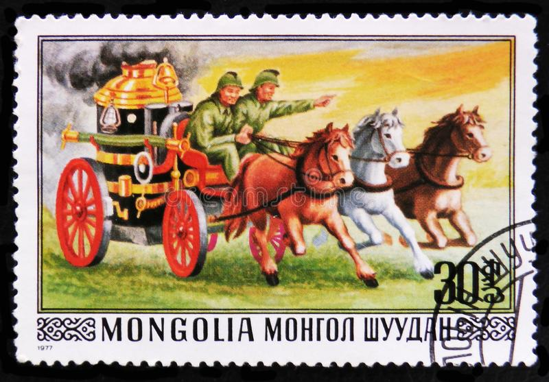 Firefighting carriage and horses, circa 1977. MOSCOW, RUSSIA - APRIL 2, 2017: A post stamp printed in Mongolia shows firefighting carriage and horses, circa 1977 stock photo