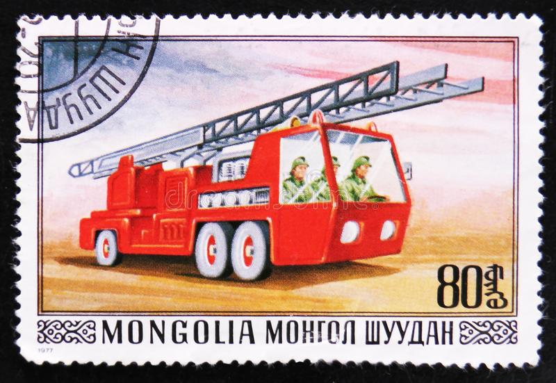 Firefighting truck with ledder, series, circa 1977. MOSCOW, RUSSIA - APRIL 2, 2017: A post stamp printed in Mongolia shows Firefighting truck with ledder, series stock photos