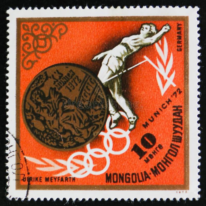 High jump woman, german athlete Ulrike Meyfarth. MOSCOW, RUSSIA - APRIL 2, 2017: A post stamp printed in Mongolia, shows high jump woman, german athlete Ulrike stock images